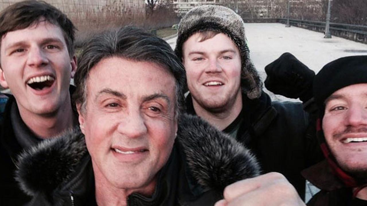 In this Jan. 17, 2015, photo provided by Peter Rowe, Rowe, right, takes a selfie with friends Jacob Kerstan, left, Andrew Wright, third from left and actor Sylvester Stallone.