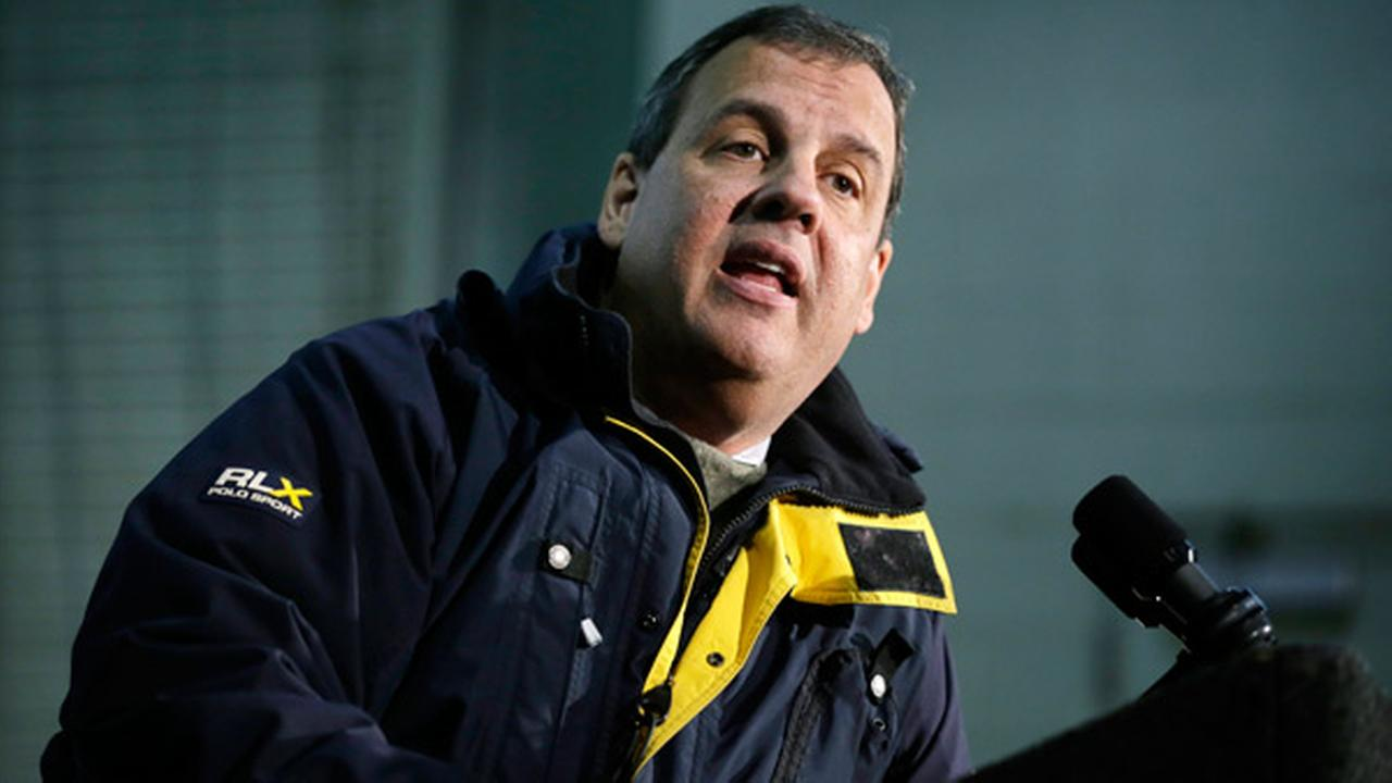 New Jersey Gov. Chris Christie answers a question, while addressing a gathering over the impending snow storm.