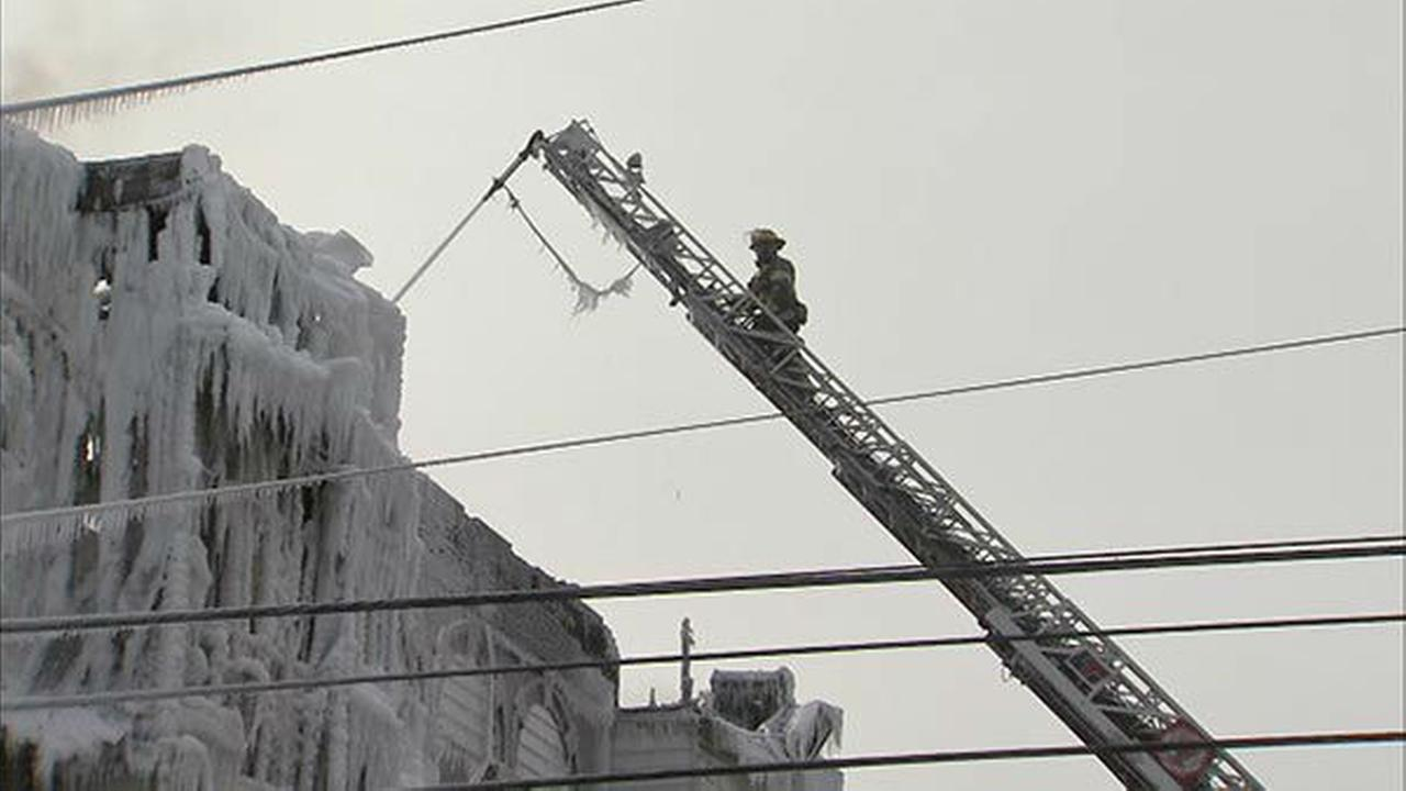 PHOTOS: Fire leaves buildings covered in ice