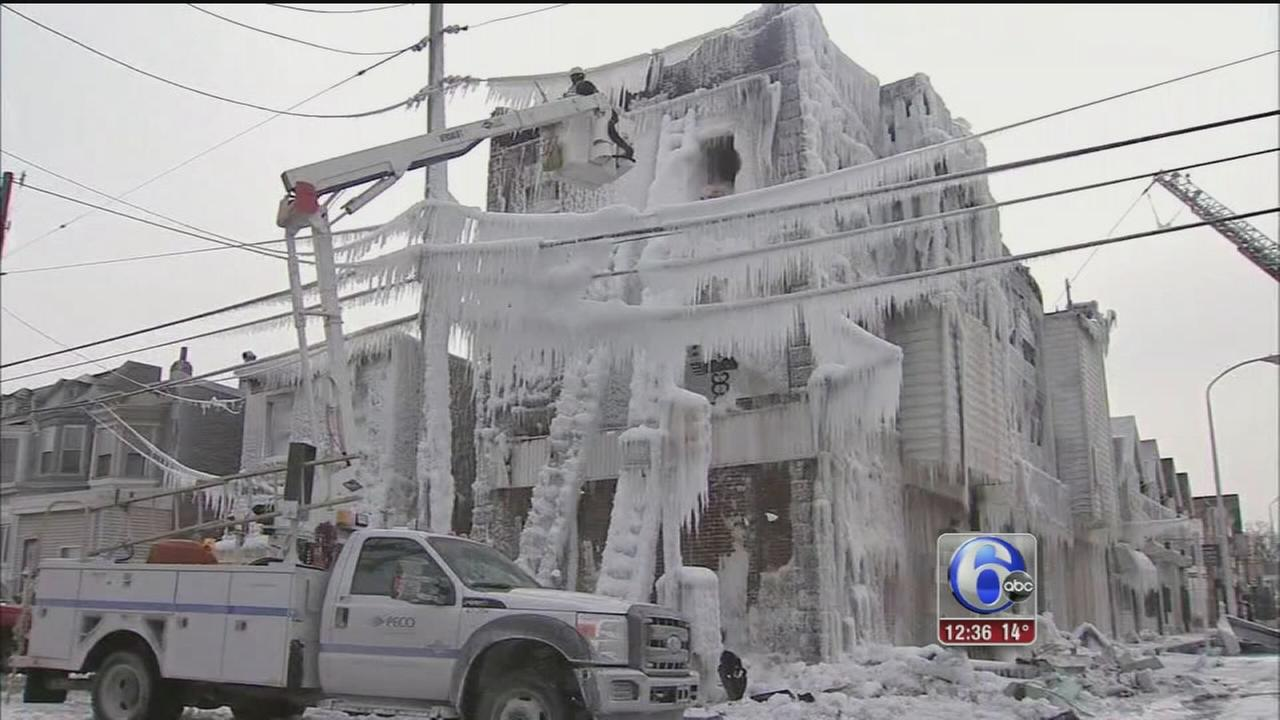 VIDEO: Ice forms as crews battle flames in 3-story building