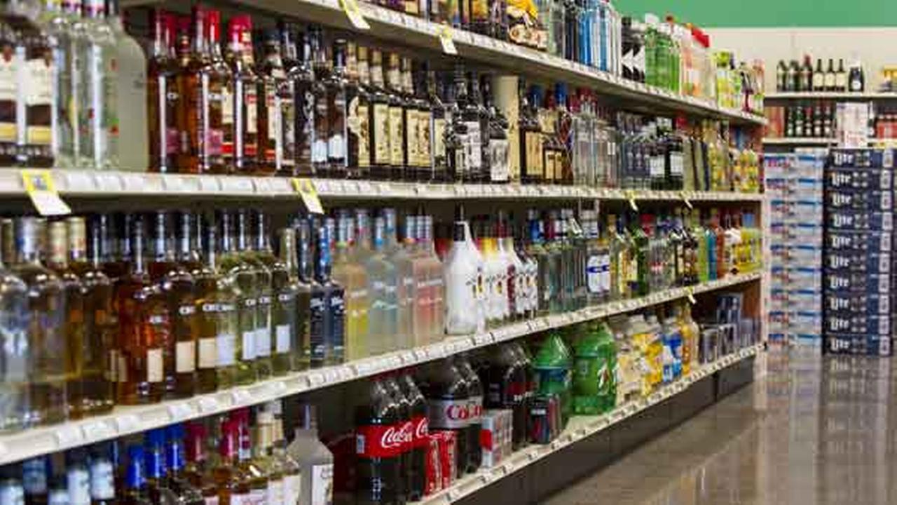 Shelves are filled with bottles of liquor Thursday, Feb. 19, 2015.