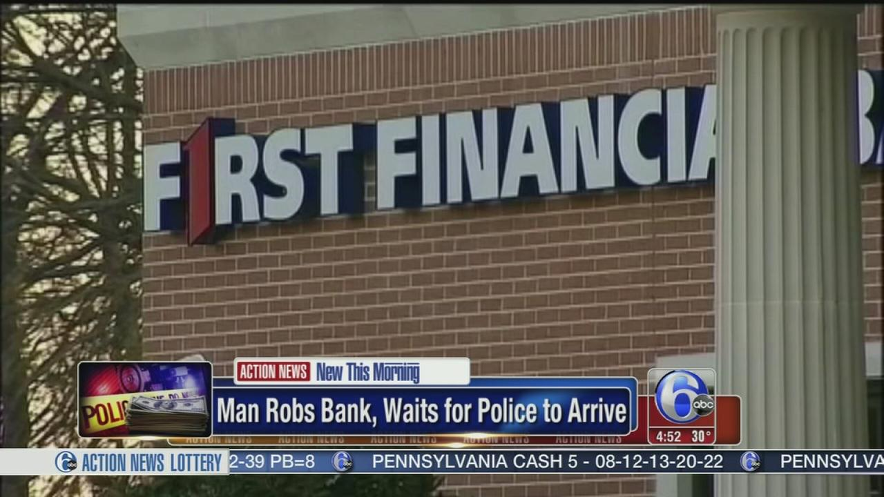 VIDEO: Man robs bank then waits for police