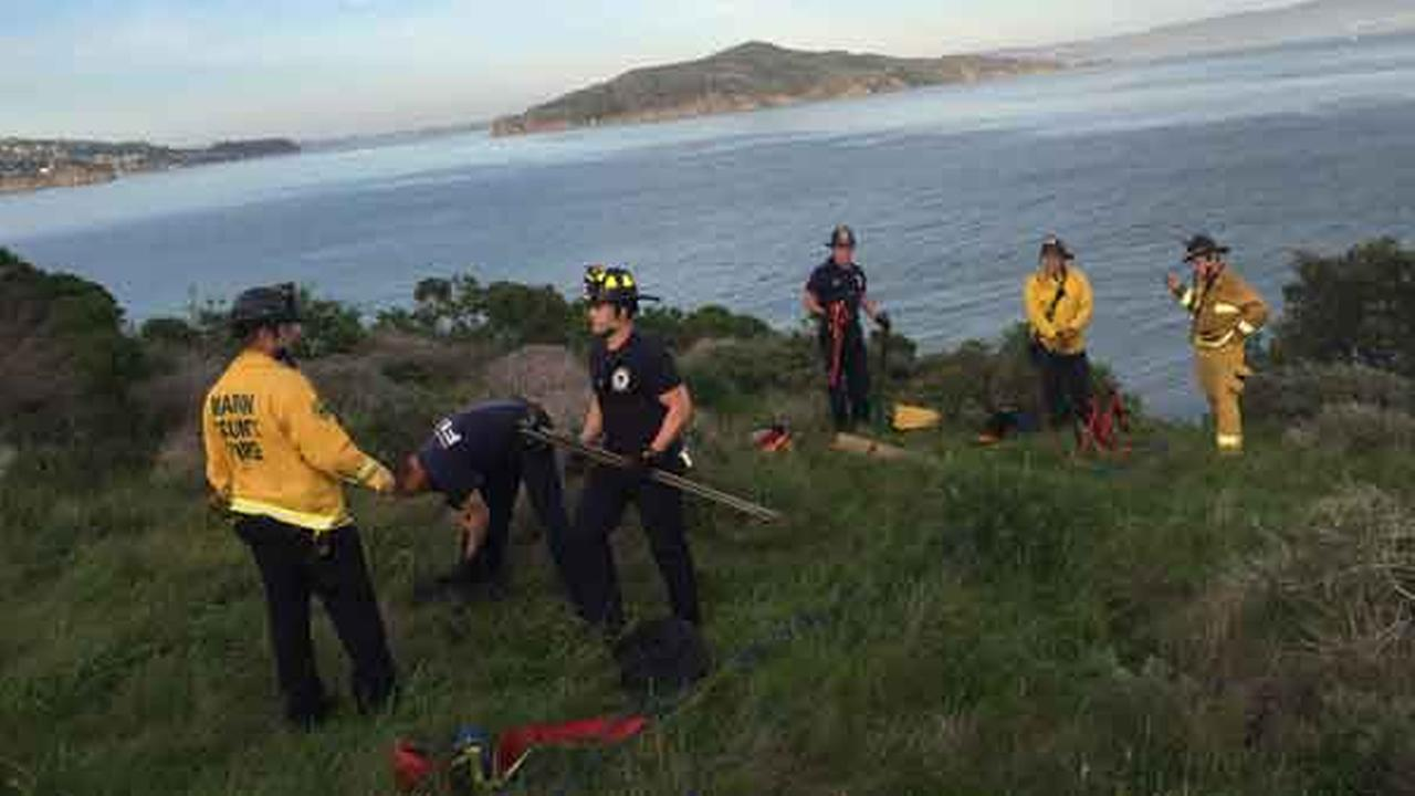 The South Marin County Fire and Rescue suit up to help the National Park rangers pull one of the suspects to safety Thursday Feb. 26, 2015.