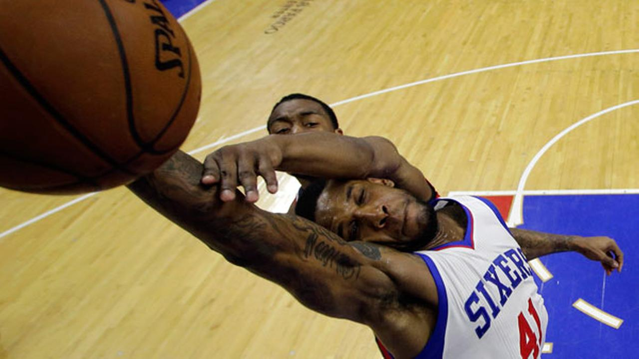 Washington Wizards John Wall, top, fouls Philadelphia 76ers Thomas Robinson during the second half of an NBA basketball game, Friday, Feb. 27, 2015, in Philadelphia. Philadelphia