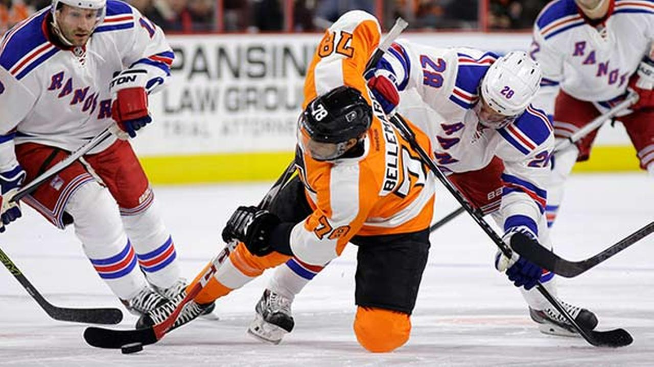 Philadelphia Flyers Pierre-Edouard Bellemare (78) battles for the puck against New York Rangers Dominic Moore (28) during the first period on Saturday, Feb. 28, 2015.