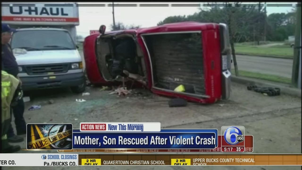 VIDEO: Mother, son rescued after violent crash