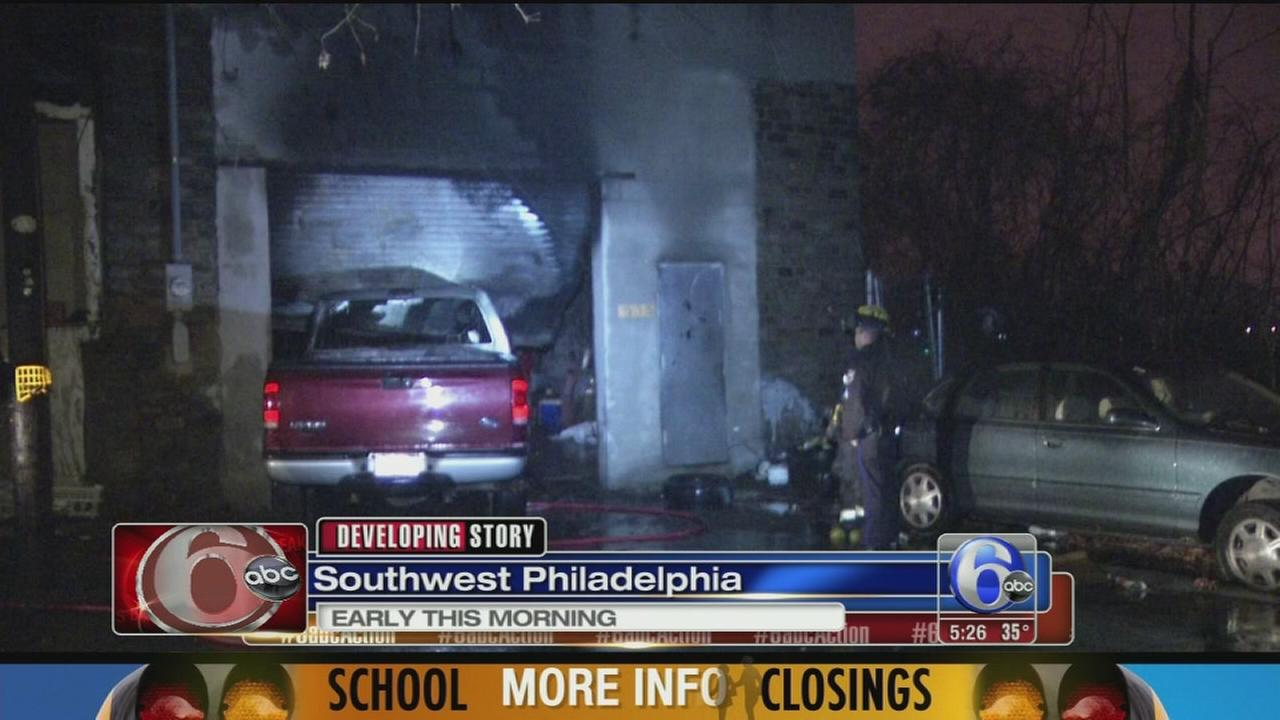 VIDEO: Truck bursts into flames after crashing into garage in SW Philly