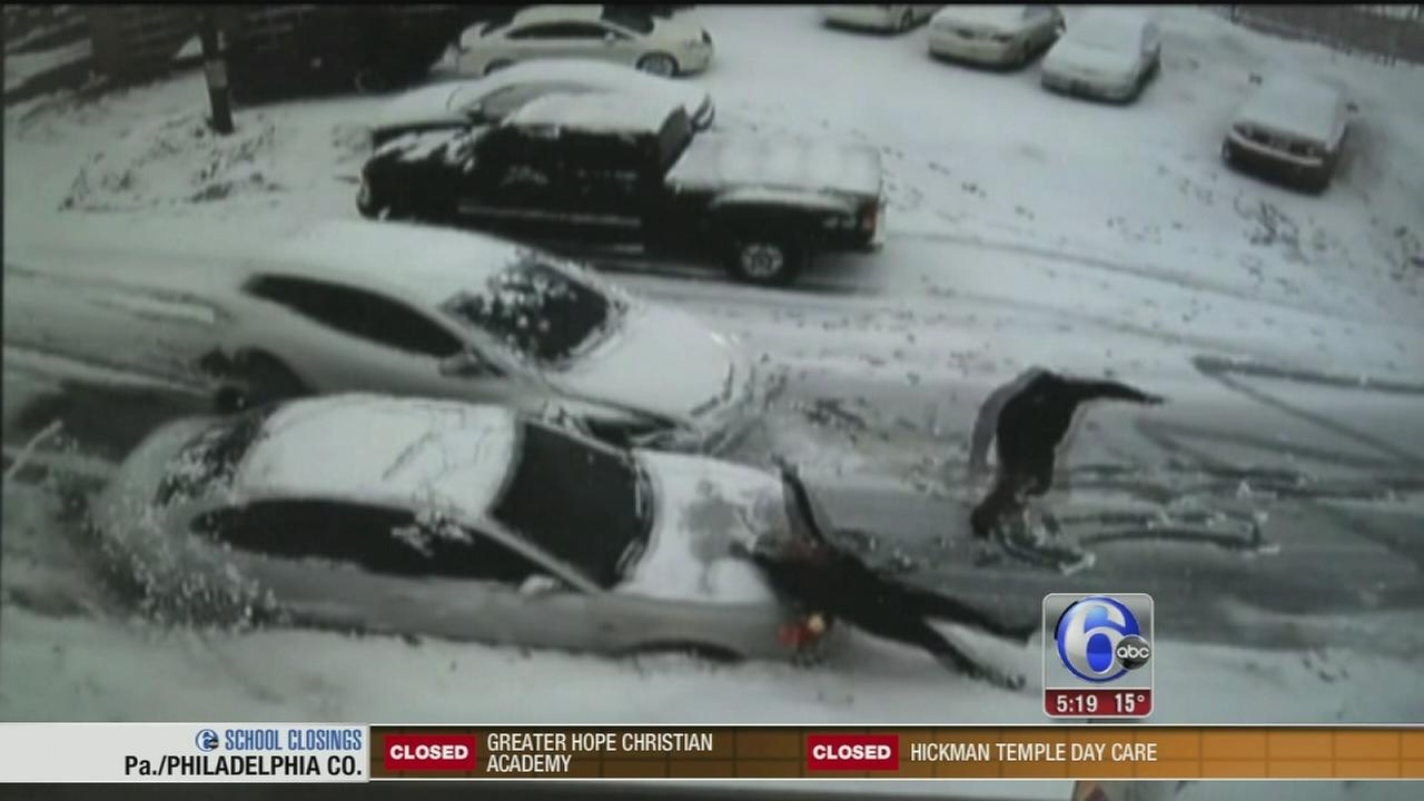 VIDEO: Cars slide on icy road, woman struck