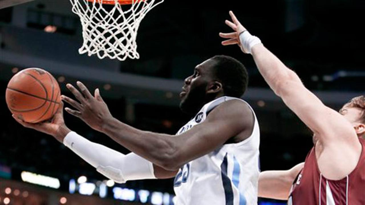 Villanovas Daniel Ochefu, left, shoots past Lafayettes Bryce Scott during the first half of an NCAA tournament second round college basketball game, Thursday, March 19, 2015