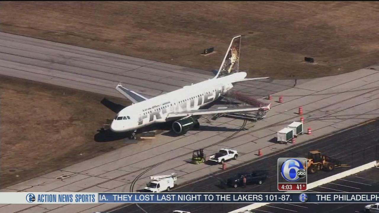 VIDEO: Plane gets stuck in mud at New Castle airport