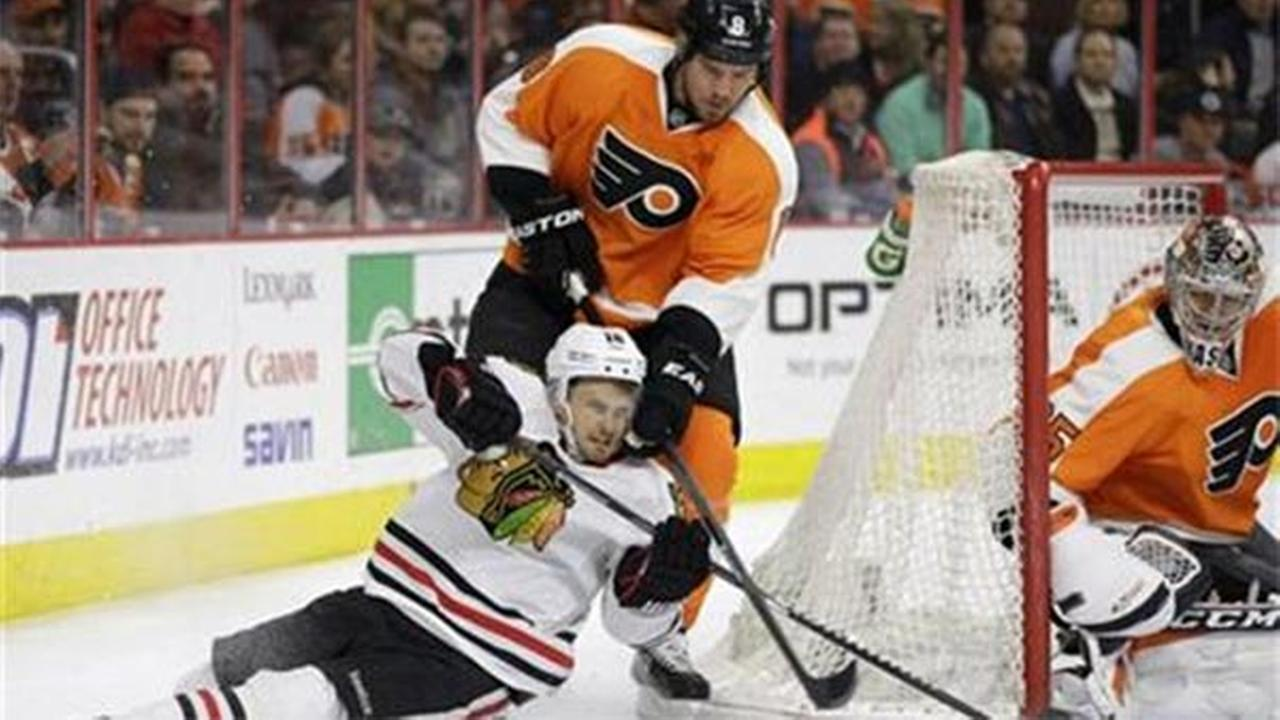 Chicago Blackhawks  Marcus Kruger (left), Philadelphia Flyers Nicklas Grossmann (center) and Steve Mason, Wednesday, March 25, 2015, in Philadelphia.