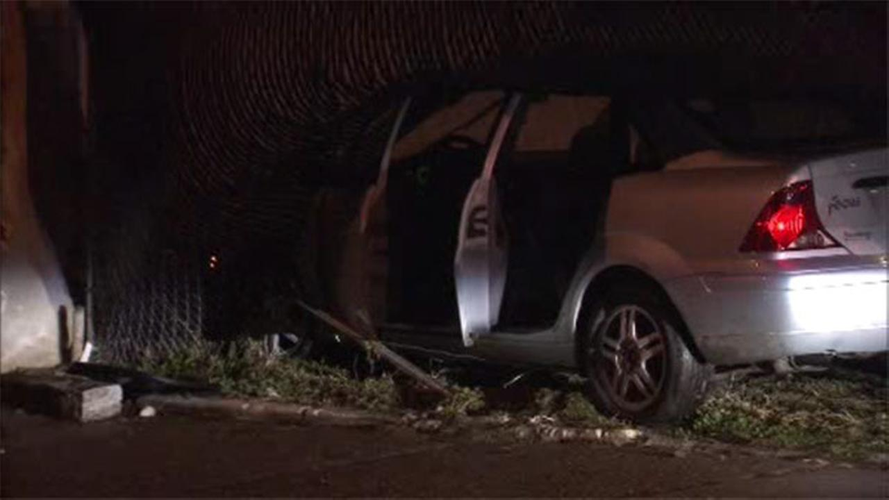 Car crashes through gate, bounces off house in Brewerytown