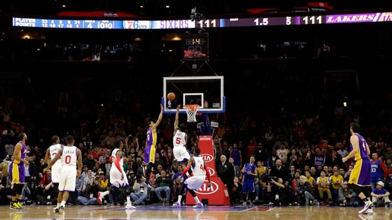 Los Angeles Lakers Jordan Clarkson (6) shoots the game-winning basket over Philadelphia 76ers Ish Smith (5) during the final seconds of overtime in an NBA basketball game.