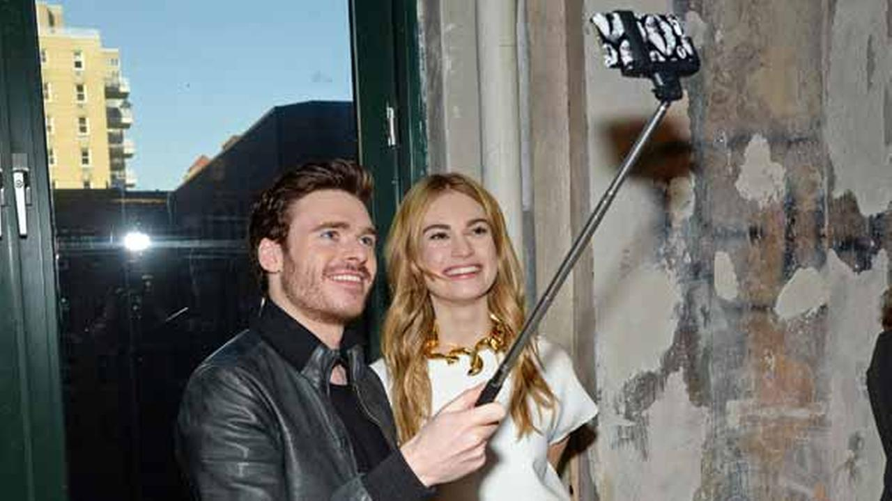 FILE - In this March 9, 2015 file photo, actors Richard Madden and Lily James take a selfie while attending AOLs BUILD Speaker Series.