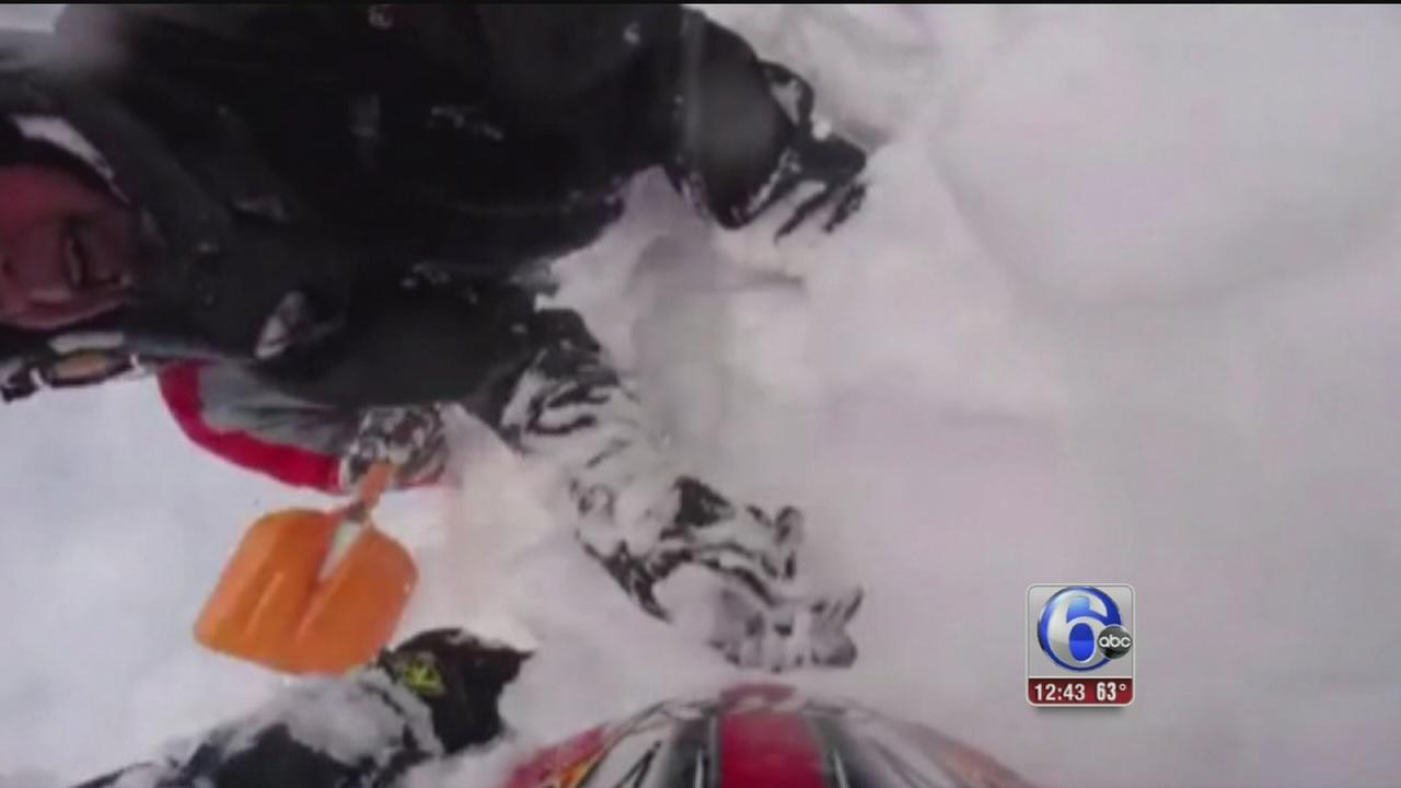 VIDEO: Snowmobiler trapped