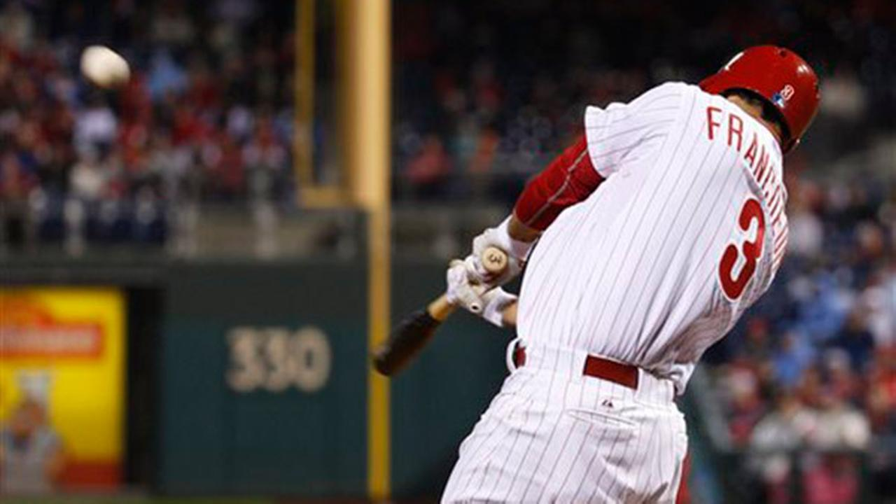 Philadelphia Phillies Jeff Francoeur hits a three-run home run during the sixth inning of a baseball game against the Boston Red Sox, Wednesday, April 8, 2015.