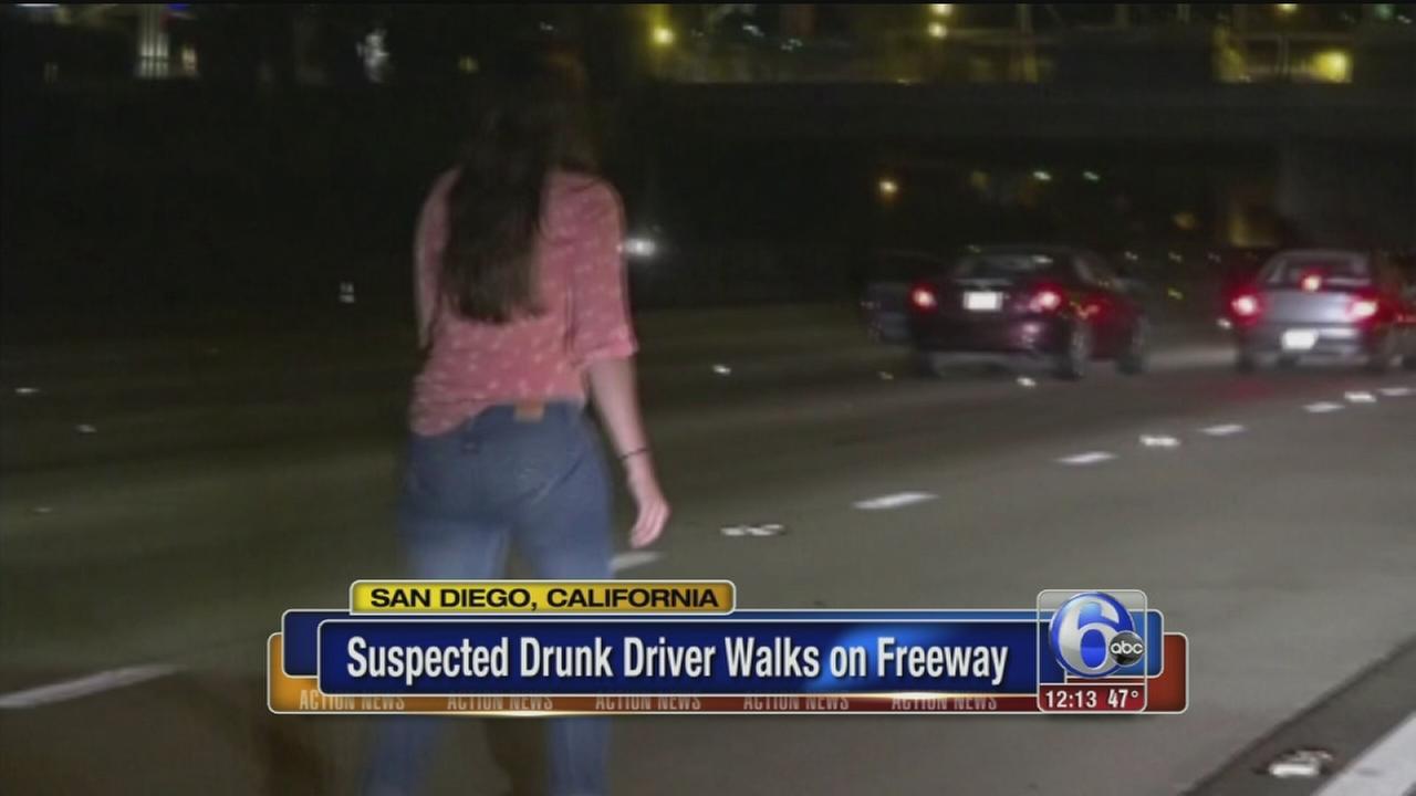 VIDEO: Bystanders horrified as woman walks down freeway