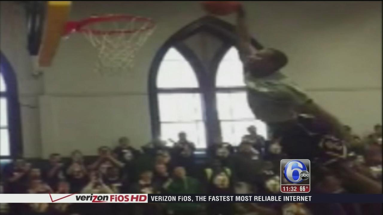 VIDEO: Local HS basketball star dunks over 4 students