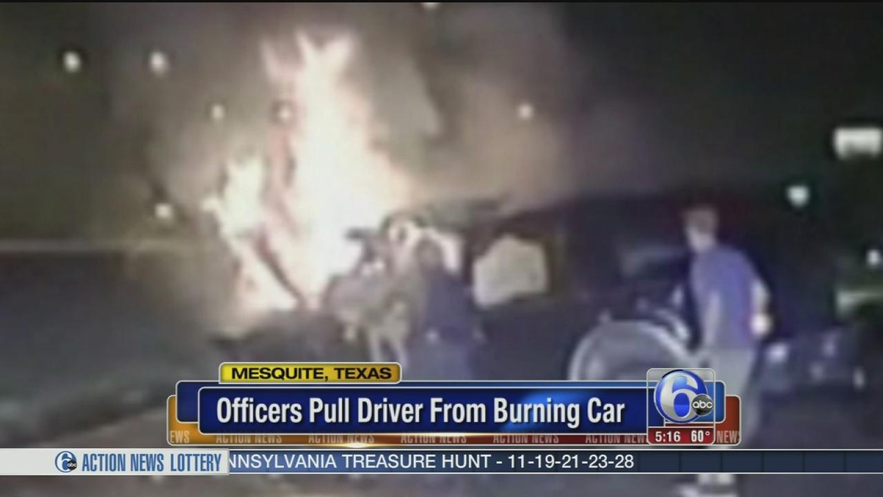 VIDEO: Officers pull driver from burning car