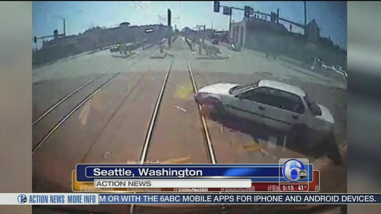 VIDEO:  Car and train collide in Seattle