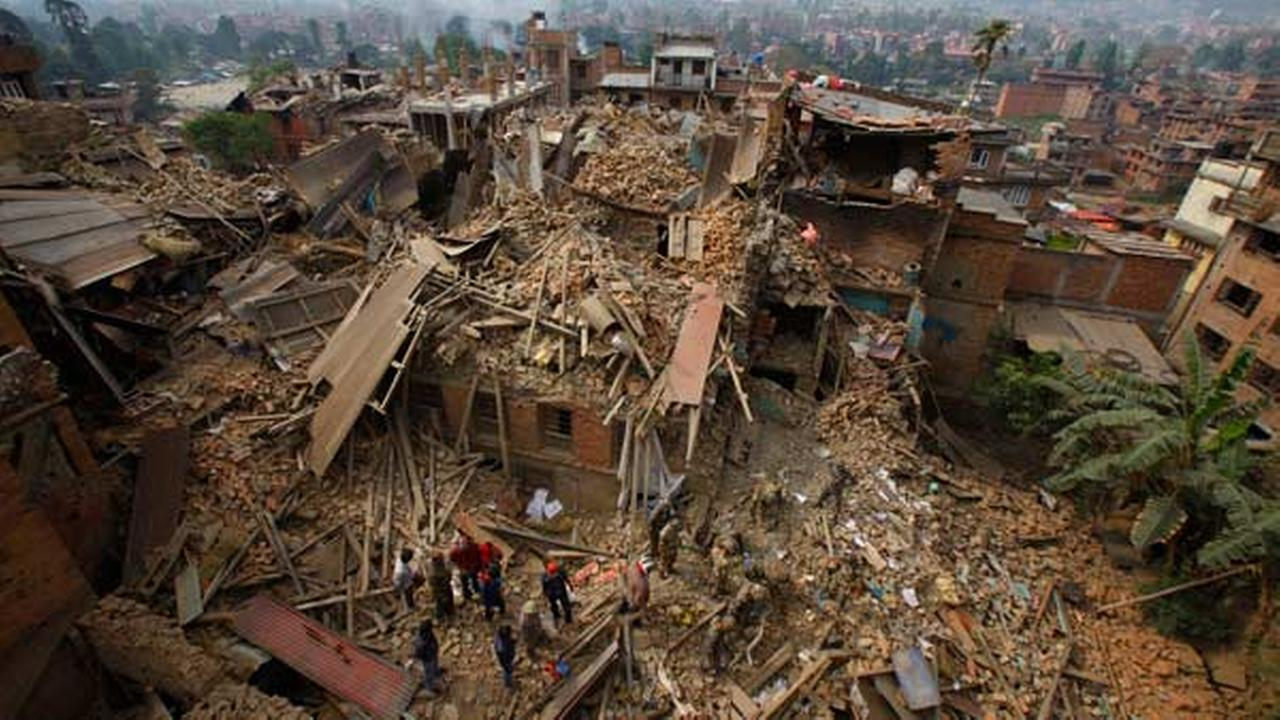 Rescue workers remove debris as they search for victims of earthquake in Bhaktapur near Kathmandu, Nepal, Sunday, April 26, 2015.