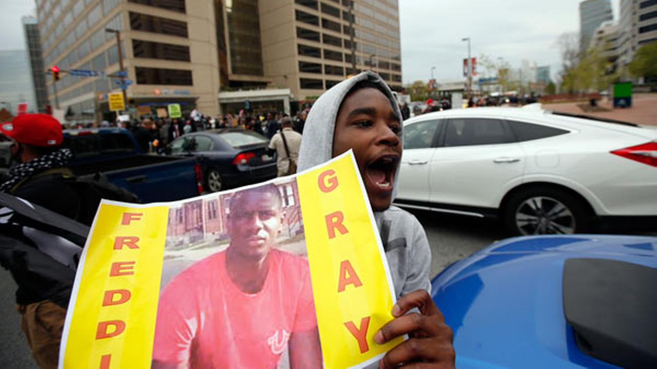 Marchers block the Pratt Street after a march to City Hall for Freddie Gray, Saturday, April 25, 2015 in Baltimore.