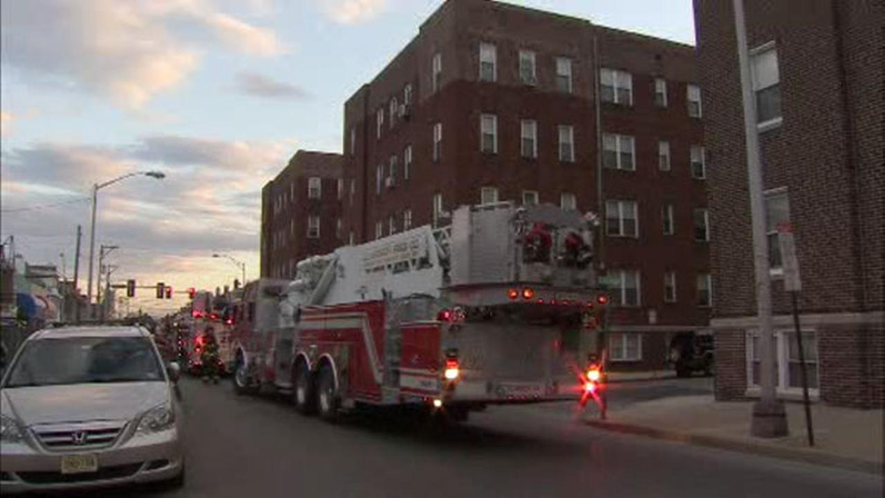 Firefighters remove residents from building in Upper Darby, Pa.