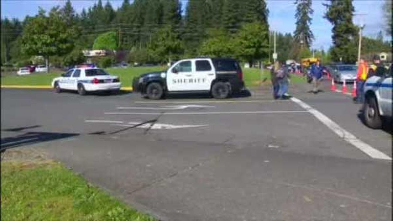 A government teacher is being hailed as a hero after tackling a 16-year-old student who fired two shots into the air Monday at a Washington state high school.