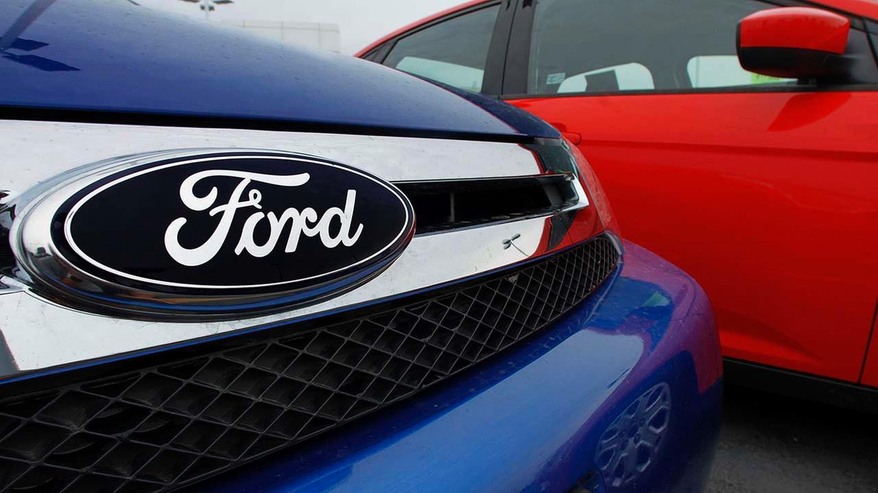 The Ford logo is seen on cars for sale at a Ford dealership in Springfield, Ill