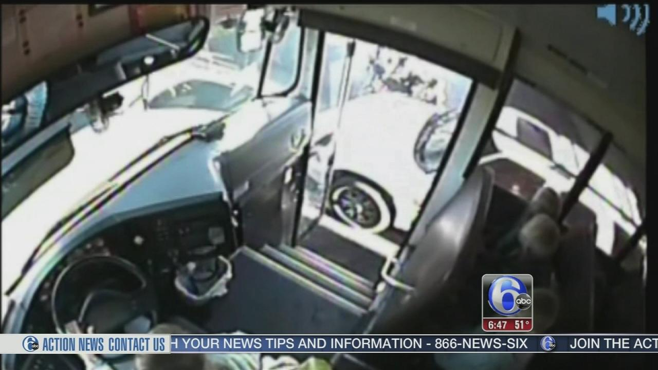 VIDEO: SUV nearly plows into kids getting on bus