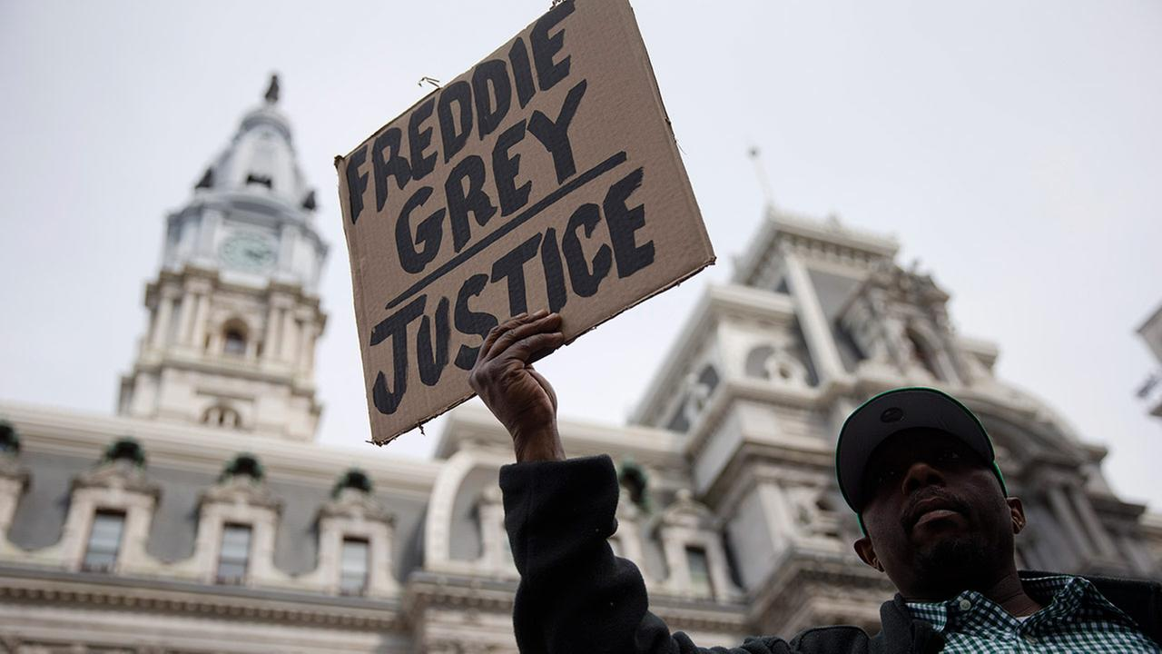 Protesters rush a police line after a rally at City Hall in Philadelphia on Thursday, April 30, 2015. (AP Photo/Matt Rourke)