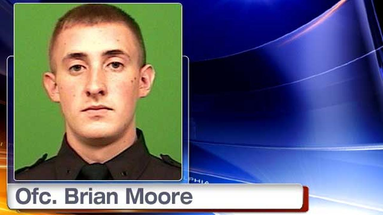 This undated photo released by the New York City Police Department shows officer Brian Moore.