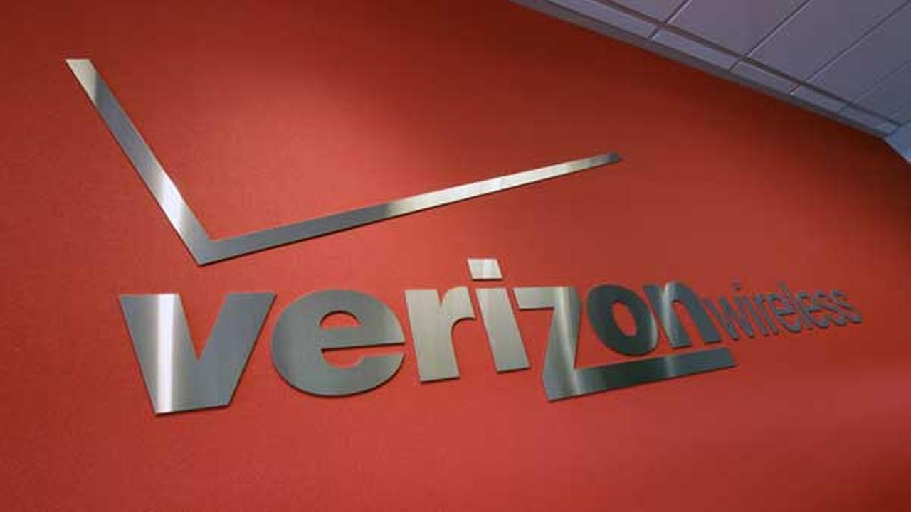FILE- In this Tuesday, June 12, 2012, file photo, the Verizon logo is seen at Verizon store.