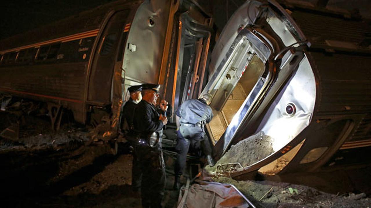Emergency personnel work the scene of a train wreck, Tuesday, May 12, 2015, in Philadelphia.AP Photo/Joseph Kaczmarek