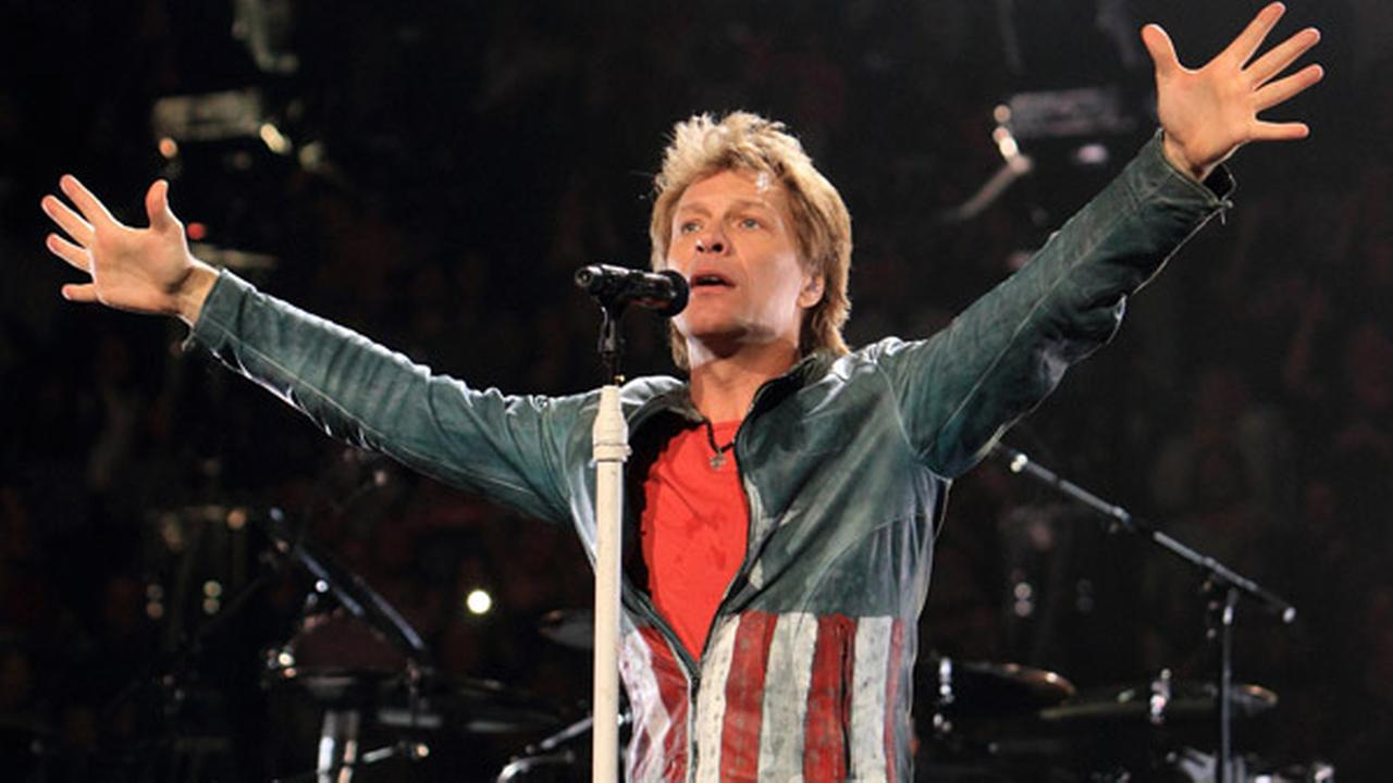 FILE - In this Nov. 5, 2013 file photo, Jon Bon Jovi performs in concert with his band Bon Jovi on their Because We Can Tour 2013, in Philadelphia.