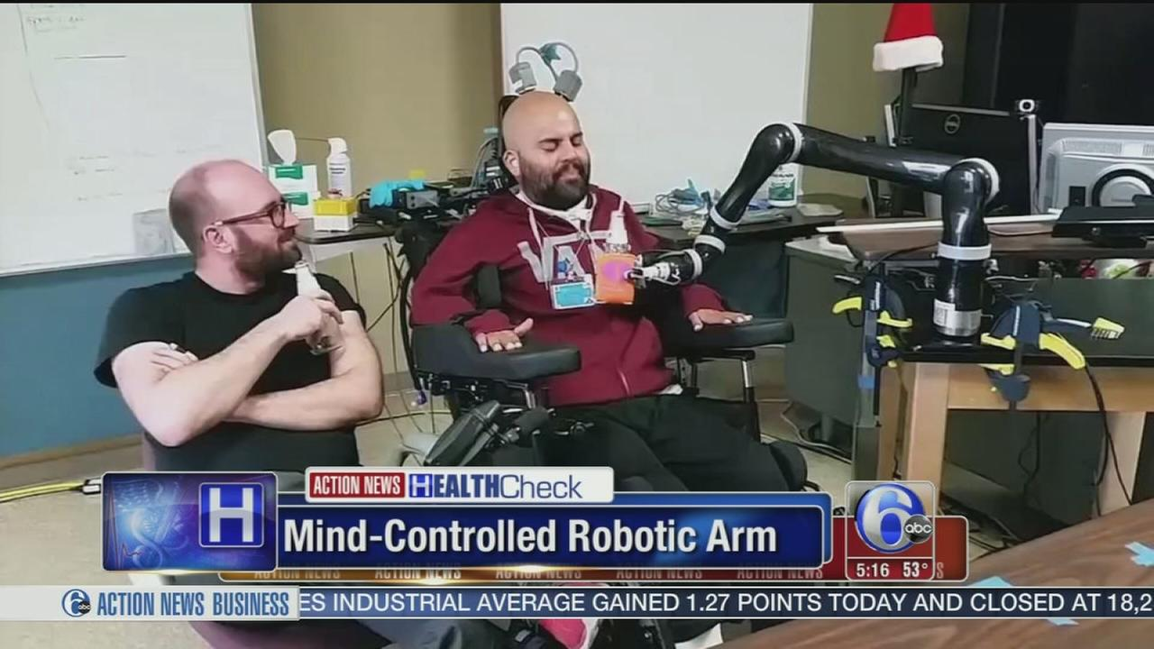 VIDEO: Man uses mind-controlled robotic arm