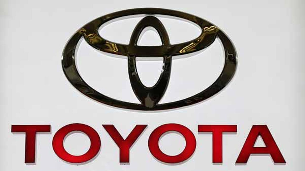 This Photo taken Feb. 14, 2013 shows the Toyota logo on a sign at the 2013 Pittsburgh Auto Show in Pittsburgh. (AP Photo/Gene J. Puskar)