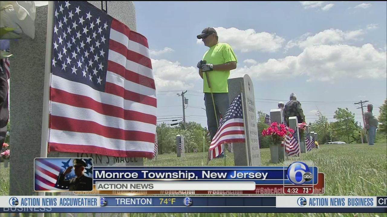 VIDEO: Volunteers plant flags at Gloucester Co. cemetery