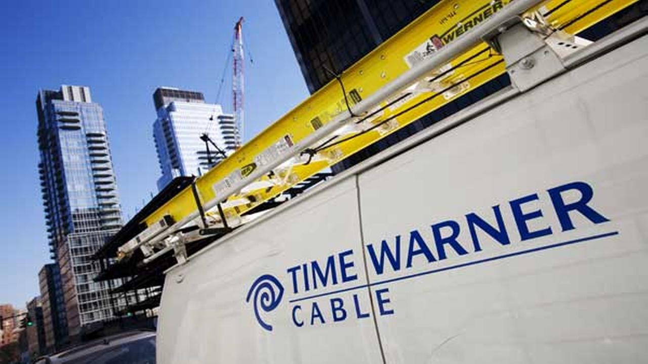 FILE - This file photo shows a Time Warner Cable truck in New York .