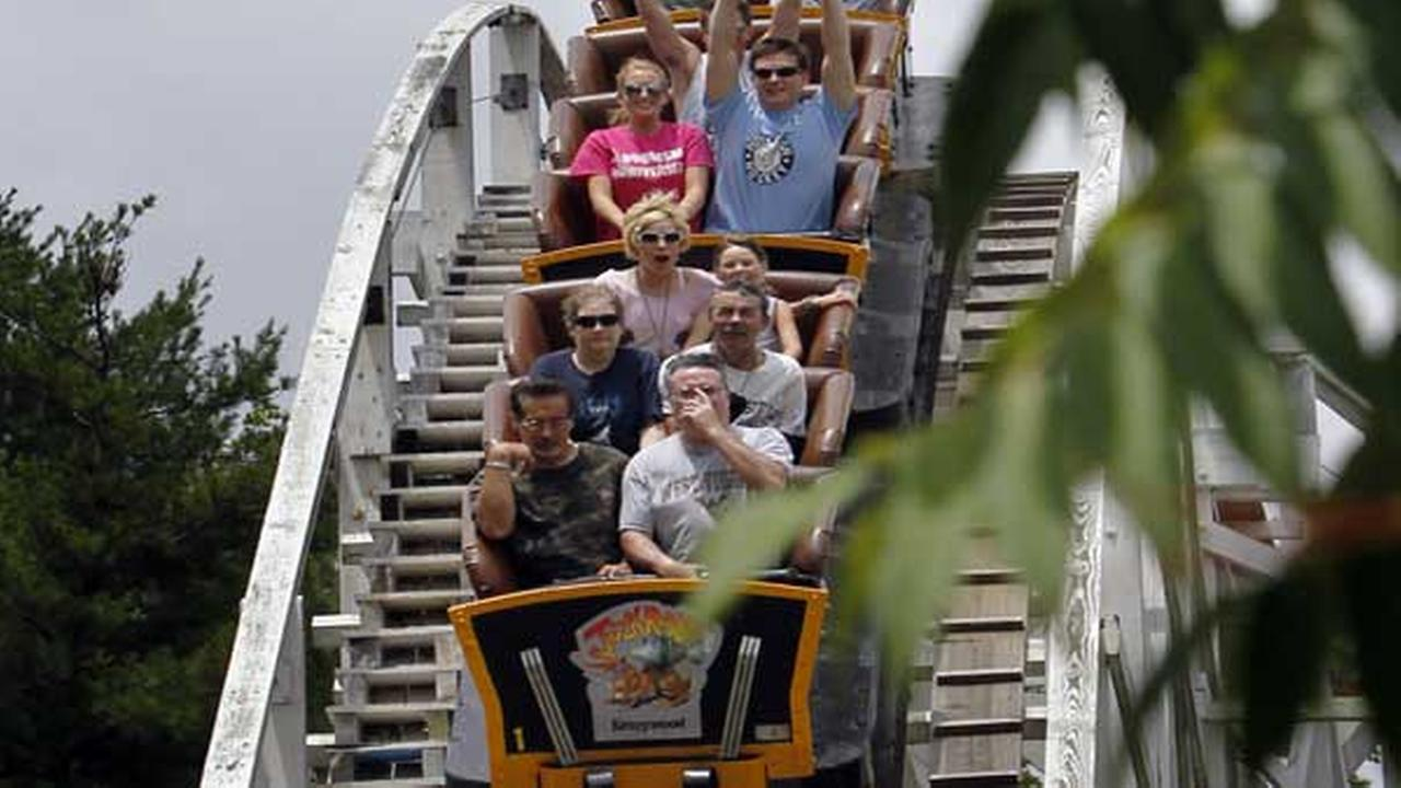 In this June 16, 2010 file photo, riders go down one of the hills on the Jack Rabbit roller coaster at Kennywood Park in West Mifflin, Pa.