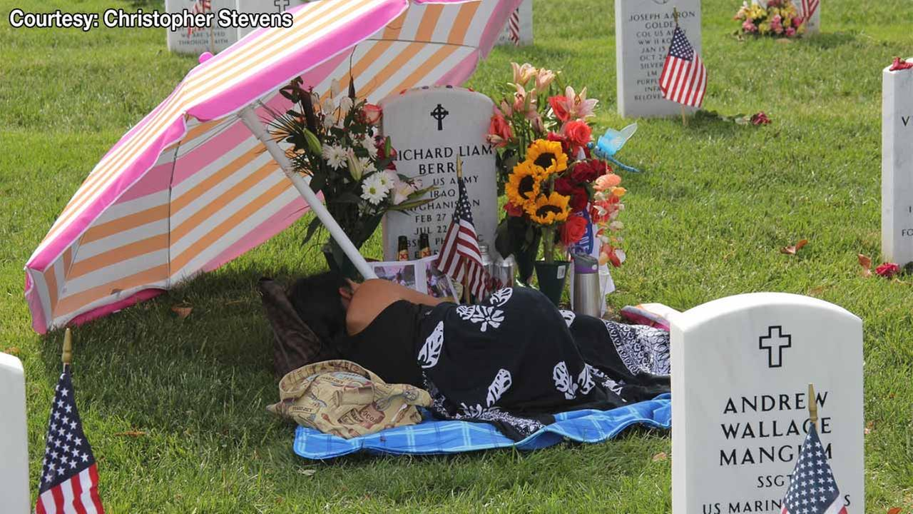 This 2014 photo shows Laureen Lopez-Berry at Arlington National Cemetery next to the grave of her husband, Army Staff Sgt. Richard Berry.