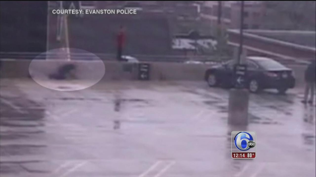 VIDEO: Officer pulls man from parking garage ledge in Chicago