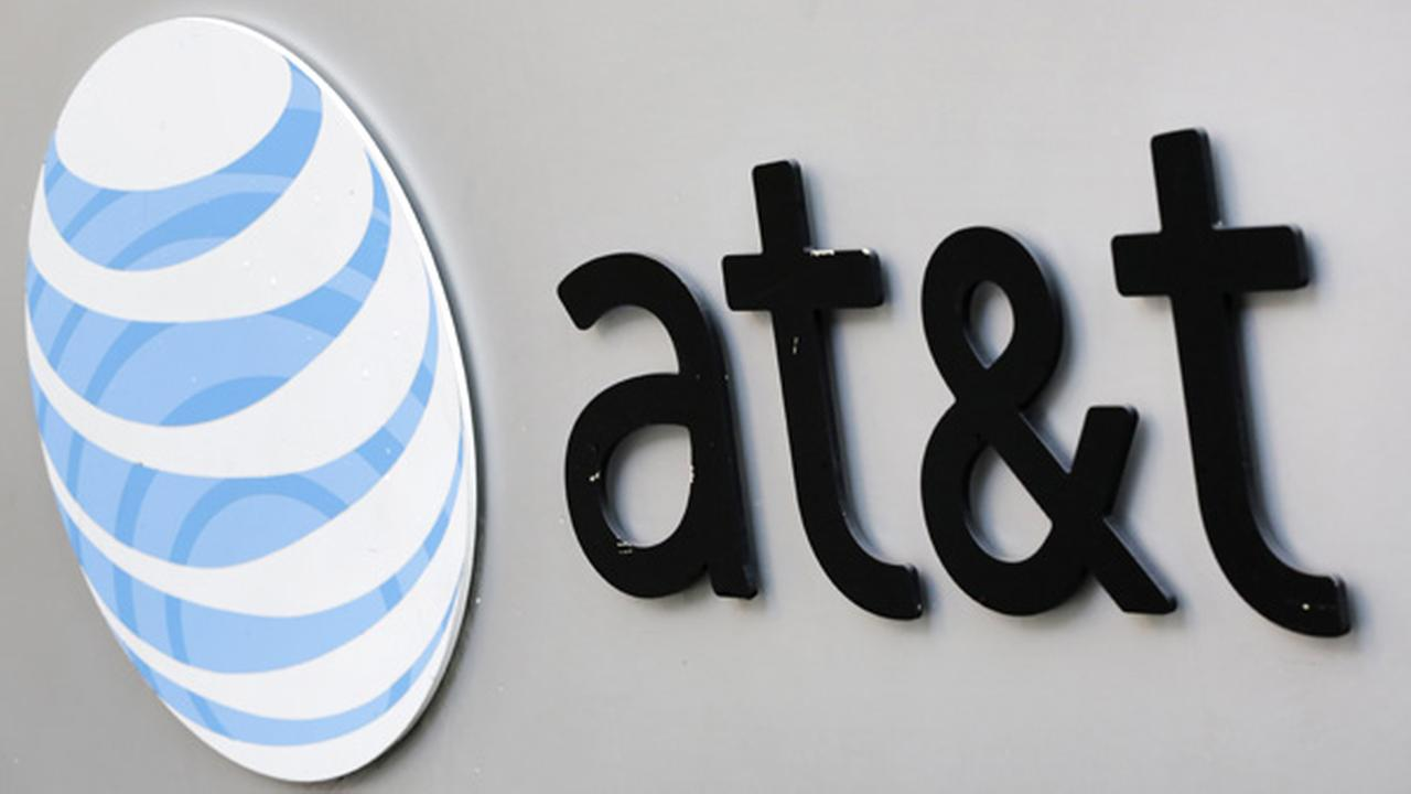 The corporate logo for AT&T is shown on the outside of one of its New York facilities, Tuesday, April 21, 2015.