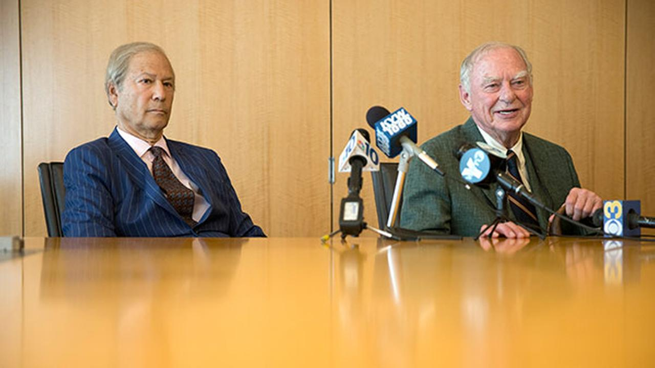 Businessman Lewis Katz, left, and philanthropist H.G. Gerry Lenfest speak at a news conference after an auction to buy the The Philadelphia Inquirer and Philadelphia Daily News.