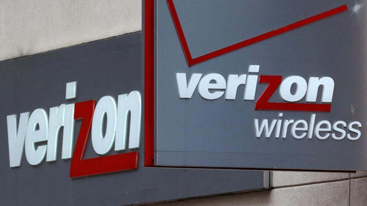 FILE - This June 4, 2014 file photo shows signage at a Verizon Wireless retail store.