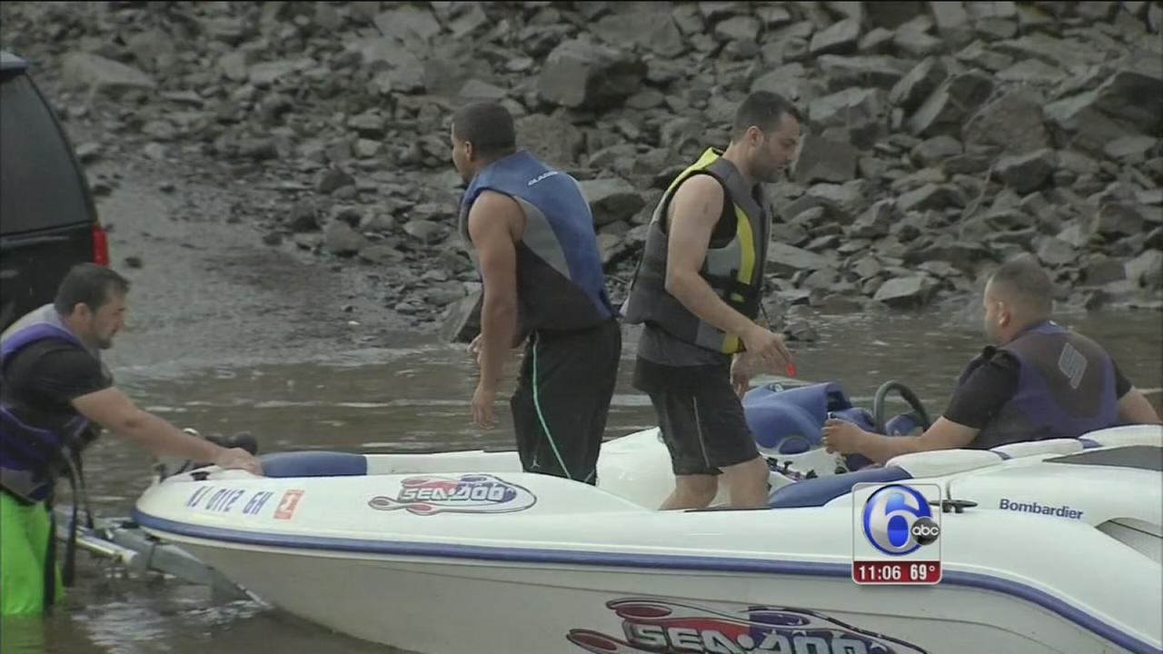 VIDEO: Jet skiers rescued in storm