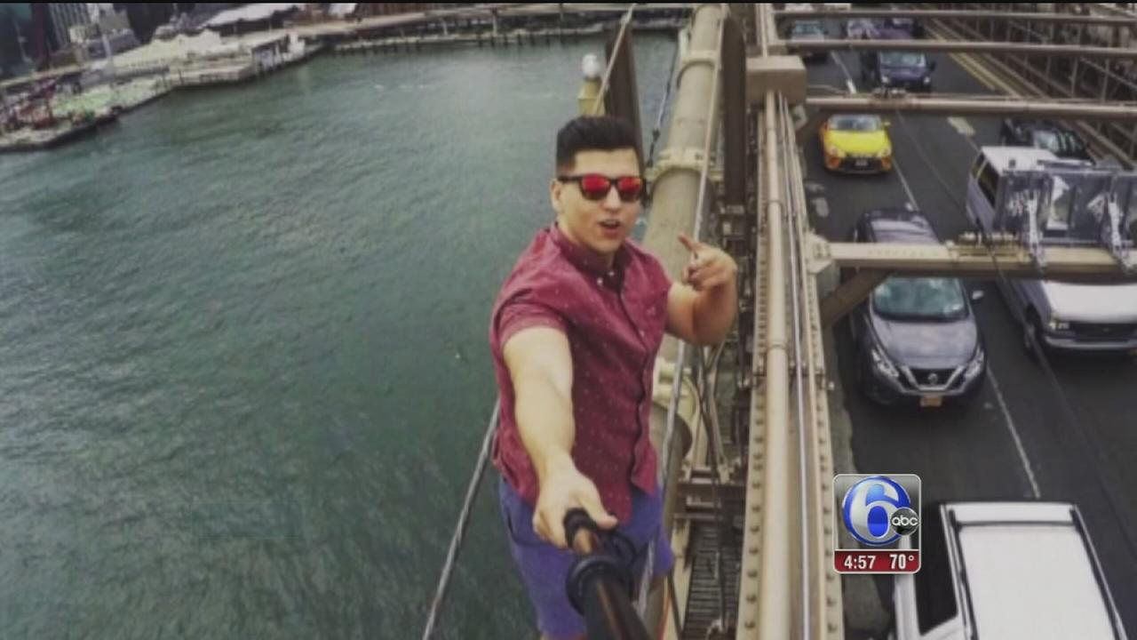 VIDEO: Man takes selfie, dangling from Brooklyn Bridge