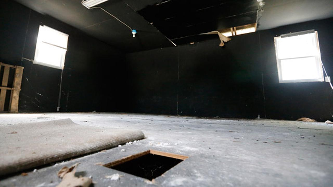 In this June 15, 2015, photo, a hole cut in the floor by investigators at the dog fighting building at the Bad Newz kennel remains during a tour of the Good Newz Rehab Center.