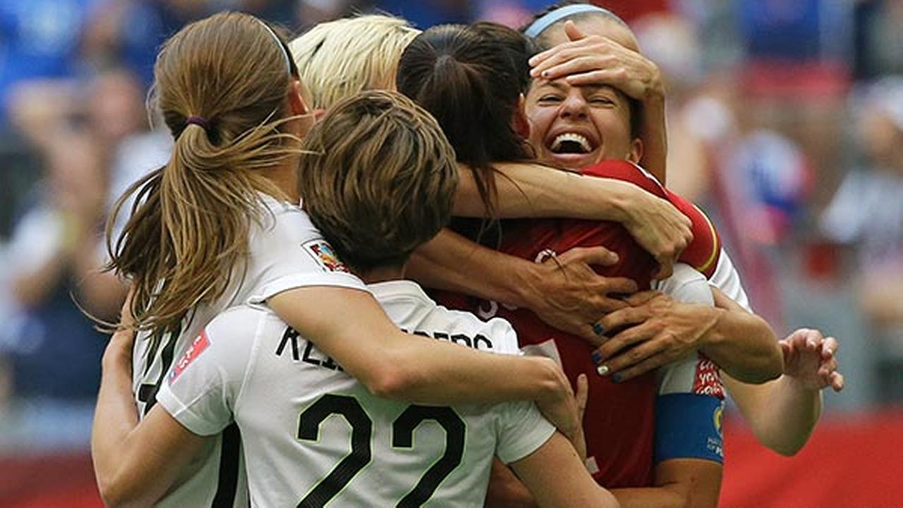 United States Carli Lloyd, right, celebrates with teammates after scoring her third goal against Japan during the FIFA Womens World Cup soccer championship, Sunday, July 5, 2015.