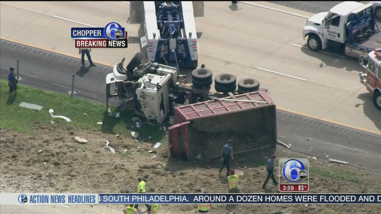 VIDEO: Dump truck overturns on Route 1